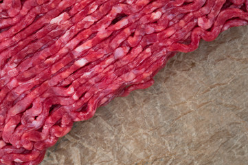 red minced meat on brown paper bag background