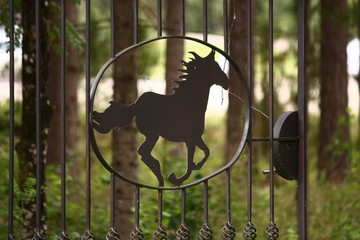 Metal fence in the shape of galloping horse