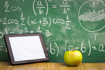 Tablet pc over blackboard