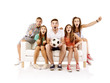 canvas print picture - Group of young people on sofa with ball