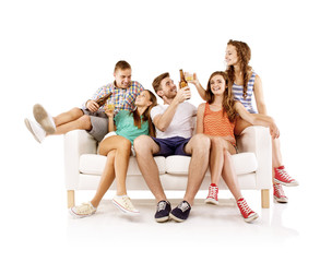 Group of young people with drinks on sofa