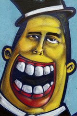 Colorful murals of the human face laughing