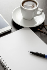 office desk composition with blank paper