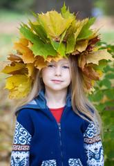 little girl in autumn crown