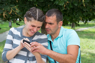 man and woman with a mobile phone