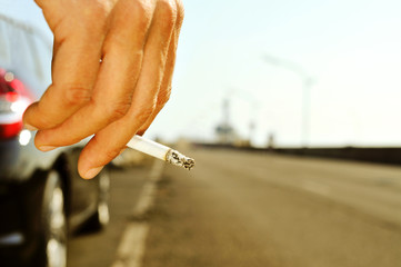 man smoking on a no traffic road