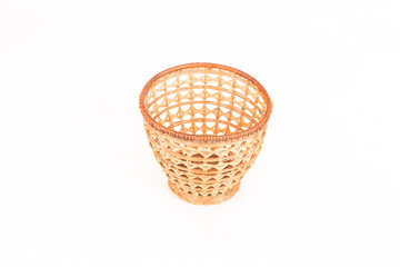 wicker basket for fruits isolated on white background
