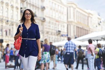 Cheerful urban girl at a city street