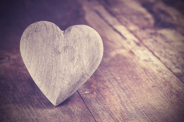 Vintage style heart on rustic wooden background, copy space.
