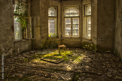 Old chair in an abandoned dilapidated house - 69378025