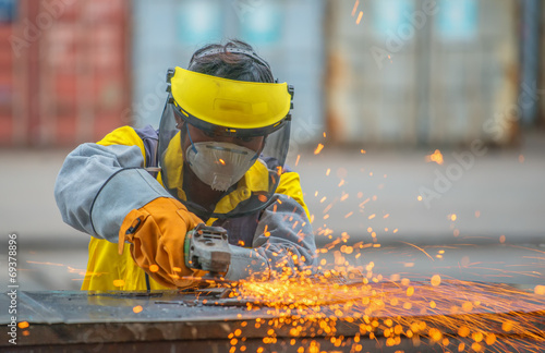 poster of Manual worker work in factory with grinder