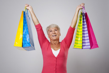 Happy senior woman with shopping bags