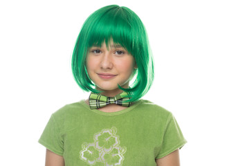 Cute pretty young girl wearing a bright green wig