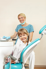 Happy little girl at the dentist. Selective focus on little girl