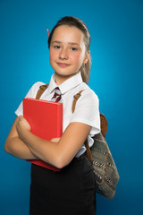 Pretty tanned young schoolgirl with a text book