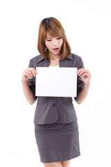 Excited business woman holding a banner, board, blank card