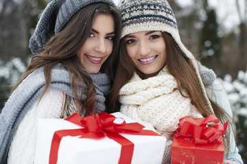 Lovely girls with Christmas gifts