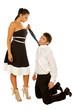girl holds the tie guy kneeling