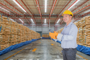 Warehouse and the sugar bag with asian worker