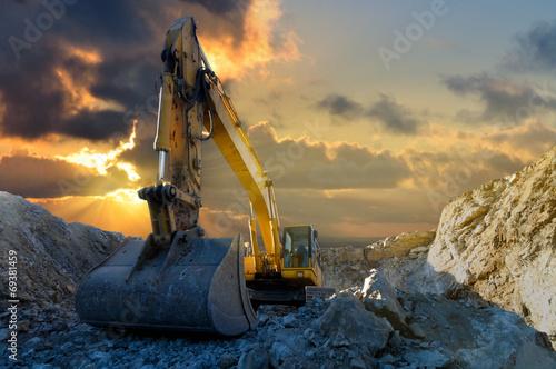 Leinwanddruck Bild Excavator in Stone Quarry