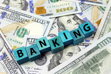 word banking on wooden cubes on american dollars background