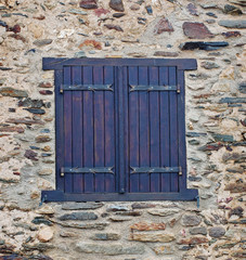 Window  in  the stone wall of an ancient building in France