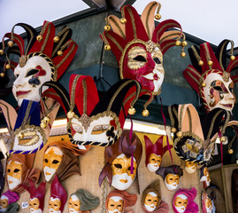 Various venetian masks on sale . colorful artistic masks on the