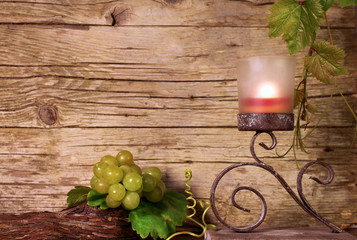 Candle holder with vine leaves and grapes