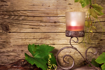 Candle holder with vine leaves