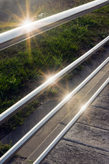 railings with sunshine reflections