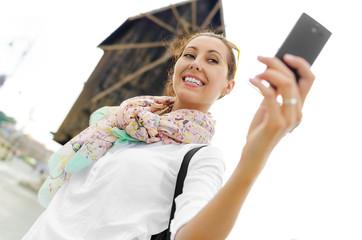 Tourist taking selfie
