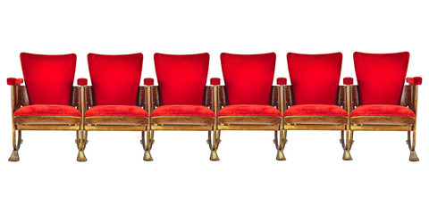 Row of six vintage cinema chairs isolated on white