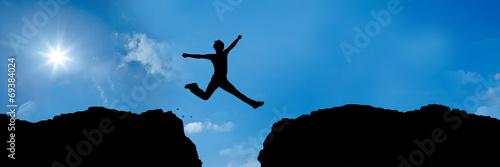 Leinwanddruck Bild jumping over a precipice between 2 mountains - 3 to 1 - g1382