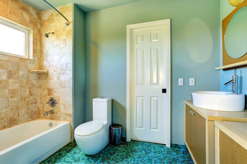 Bathroom interior in light blue with tile wall trim