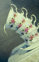 Tilted Teacups With A Splash Of Milk