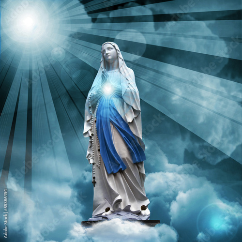 Plagát, Obraz Madonna statue with blue sky and clouds background