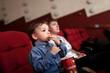 Boy eating popcorn