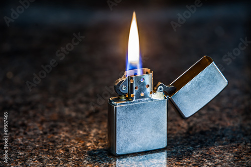 Leinwandbild Motiv Silver metal lighter