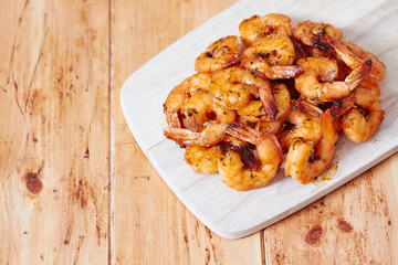 Shrimps on a wooden board
