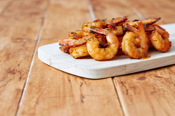 Grilled shrimps on wooden board