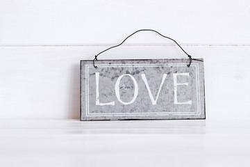 Love word written on metal plate