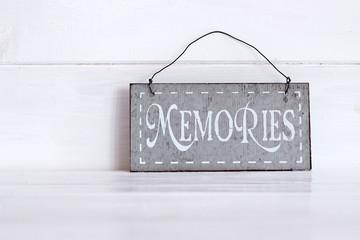 Memories word written on metal plate