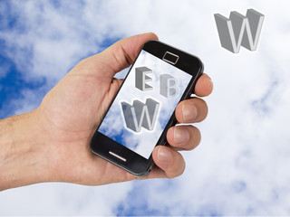 mobile and hand with sky background with internet terms