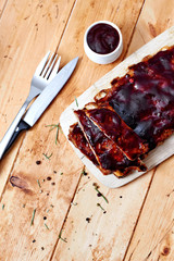 Barbecue ribs on vintage wooden table top view