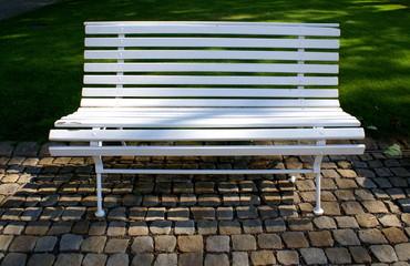 Outdoor white wooden bench in Prague