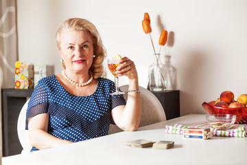 Adult woman holding an alcoholic drink