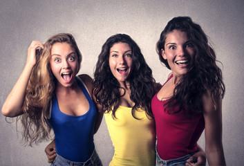 three young girls amazed