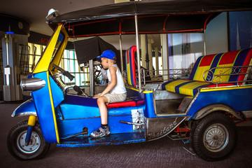 boy sitting in a tuktuk. Bangkok