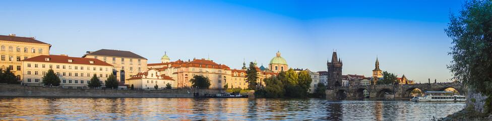 Prague, Czech Republic. View of the river bank Vltava at sunset