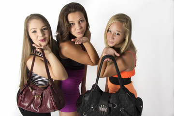 Vibrant young Teenager Girls holding there bags